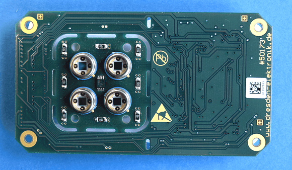 Four channel sensor electronics, placed under the fluidic channels